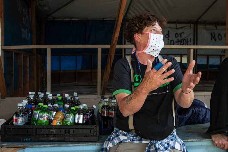 PMG PHOTO: JONATHAN HOUSE - Derinda Sikes, who is relatively new to Portland, wears a face mask while living at Right 2 Dream Too.