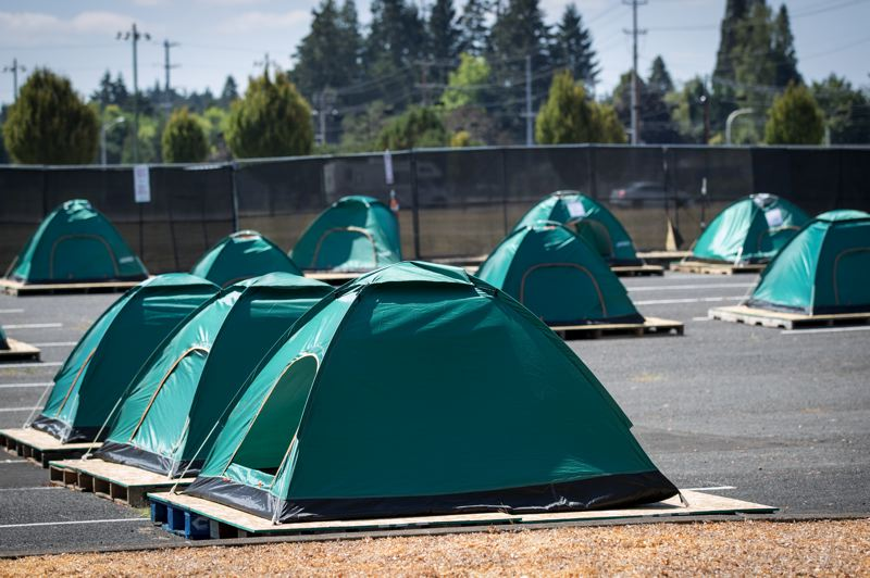 PMG PHOTO: JAIME VALDEZ - Tents pitched in a parking lot at Westside Commons, formerly known as the Washington County Fair Complex, where the county has opened a camping facility for unhoused people to reduce the risk of COVID-19 spreading in unofficial camps.