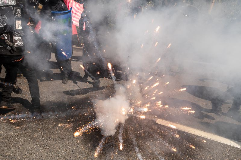 PMG PHOTO: JONATHAN HOUSE - A firework explodes during a protest in Portland on Saturday, Aug. 22.