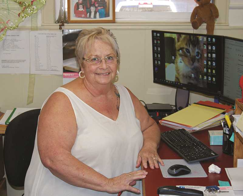 RAMONA MCCALLISTER - Colleen Ferguson, who is shown at her desk in the Crook County Administration office, has worked for Crook County for 20 years, starting upstairs in the Crook County Clerk's Office.