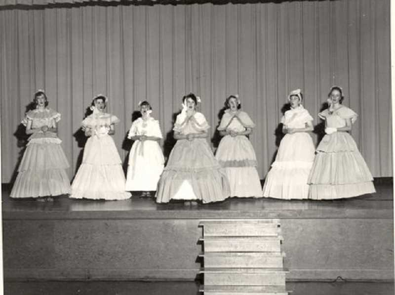 COURTESY PHOTO: WINONA GRANGE - In 1950, the grange hosted a production of a Southern Belles play. Performers included, from left, Helen Ruth Hansen, Dolores Milan, June Huskey, Loyce Martinazzi, Virginia Christensen, Kathleen Milan and Jeanne Hoggan. The hoop dresses were made by Grange women out of crepe paper.