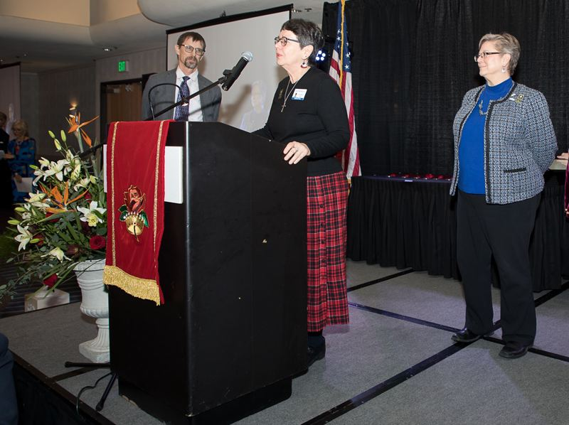 COURTESY PHOTO: BILL BARRY/ROYAL ROSARIANS - At a January 2020 awards ceremony, Pamelajean Myers of Forest Grove tells the crowd about how she and Jeannine Murrell (right) came to the rescue of their Forest Grove neighbors as John Schrag of the Pamplin Media Group looks on. The couple was nominated for a Royal Rosarian Newsmakers Award by Pamplin Media. This year, the Pamplin Media Group is producing its own Community Heroes special publication to honor outstanding local people.