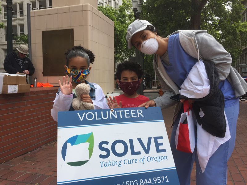 COURTESY SOLVE - Volunteers at an earlier downtown cleanup event.