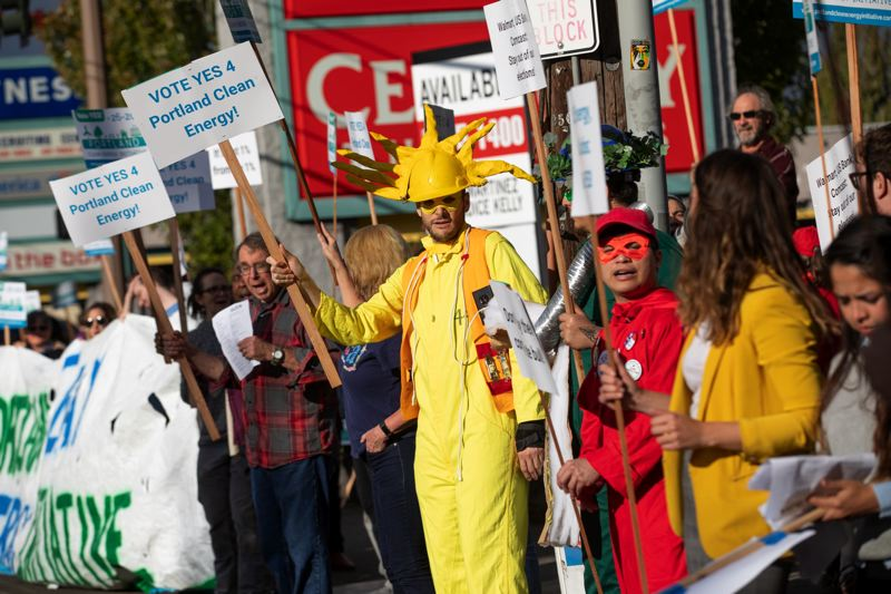 FILE - Activists rallied during rush hour Tuesday afternoon in front of the 82nd Avenue Walmart, in support of the Portland Clean Energy Initiative in 2018.