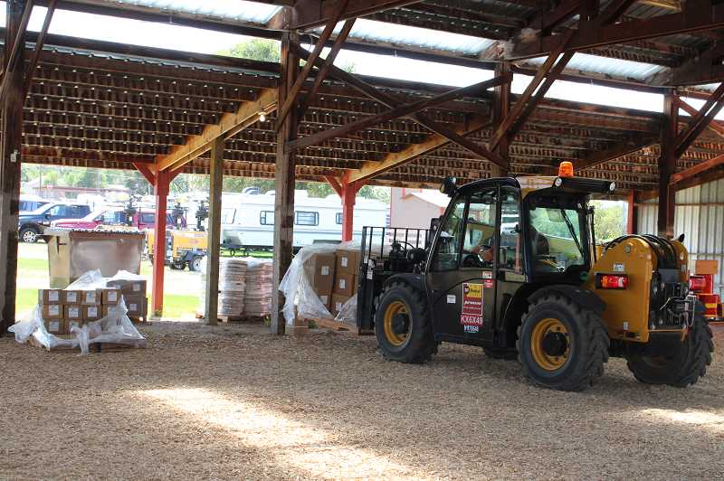 TERESA JACKSON/MADRAS PIONEER - A forklift moves supplies at the Jefferson County Fairgrounds.