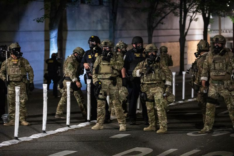 PMG FILE PHOTO - Federal agents in camouflaged uniforms guarded the Mark O. Hatfield U.S. Courthouse for weeks during sometimes violent downtown protests.