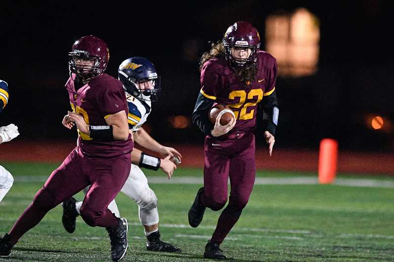 PMG PHOTO: CHRISTOPHER OERTELL - Forest Grove's Jeremy Ahmad (22) carries the ball during the Vikings' game against Hood River Valley Friday, Oct. 18, at Forest Grove High School., Forest Grove News-Times - Sports Banks wins 34-6 after jumping on Seaside early, clinches at least a share of the Cowapa League title. Prep Football Roundup: Braves, Spartans get wins, Tide and Vikings suffer defeats