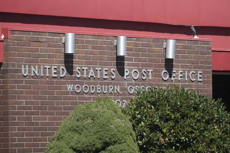 PMG PHOTO: PHIL HAWKINS - The protest at the Woodburn post office was one of 800 such rallies across the country on Aug. 22, coinciding with testimony from Postmaster General Louis Dejoy before the House Oversight Committee on Aug. 24.