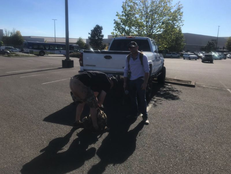 PMG PHOTO: ZANE SPARLING - Chandler Pappas, right, and an unknown associate were both spotted wearing Patriot Prater hats and carrying paint ball guns and knives around 4 p.m. at the Clackamas Town Center mall on Aug. 29 during a Trump rally in Portland.