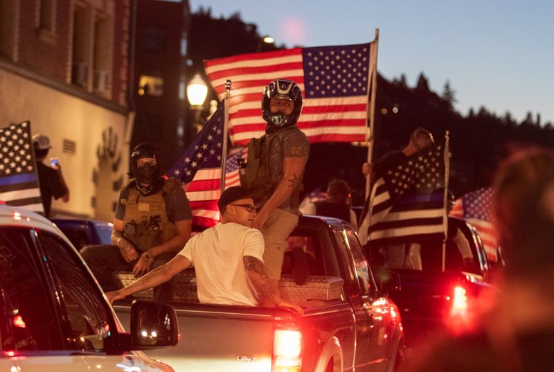 PMG PHOTO: JONATHAN HOUSE - Men wearing helmets clashed with counter-protesters after a Trump 2020 caravan wound its way through downtown Portland on Saturday evening, Aug. 29.