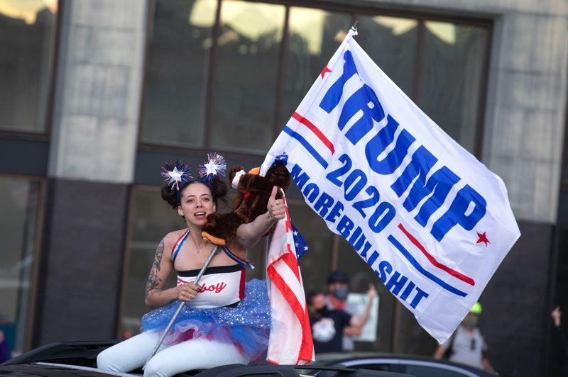 PMG PHOTO: JONATHAN HOUSE - A Trump supporter rides through downtown Portland on Saturday, Aug. 29.