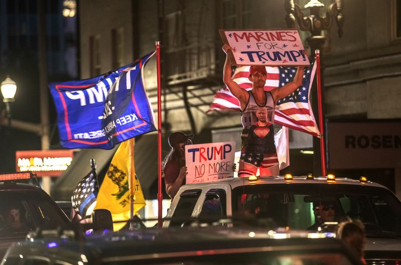 PMG PHOTO: JONATHAN HOUSE - Trump supporters drive through downtown Portland on Saturday, Aug. 29.