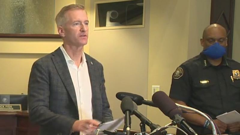 KOIN NEWS 6 - Mayor Ted wheeler speaks at Police Chief Chuck Lovell looks on at the Sunday press conference.