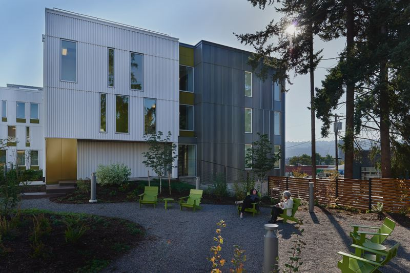 COURTESY: MWA ARCHITECTS  - The design of the affordable St. Francis Park Apartments in southeast Portland brings includes an outdoor sourtyward with residents community garden. The site is fenced off from land the church owns and has preserved as a public right of way so that people can still gather and use the fountain and public bathroom. Building management has to balance residents' desire to get off the streets and stay off the streets with residents' connections to people they may know who are still homeless.