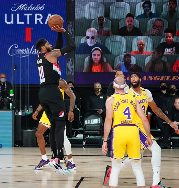 COPYRIGHT 2020 NBAE (PHOTO BY JESSE D. GARRABRANT/NBAE VIA GETTY IMAGES) - Carmelo Anthony played well in a supporting role for the Trail Blazers. Will the team sign him to a new contract?