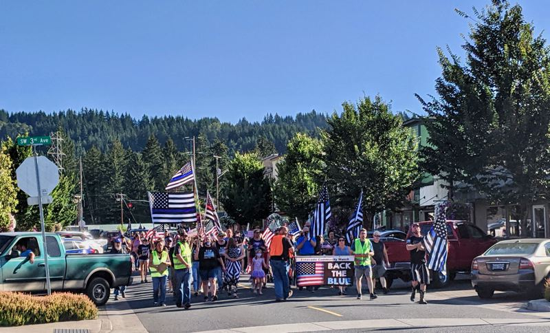 PMG PHOTO: EMILY LINDSTRAND - The Back the Blue march, organized by Estacada Community Watch, makes its way downtown on Saturday, Aug. 29.