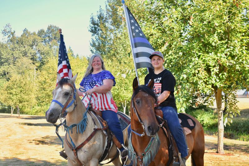 PMG PHOTO: EMILY LINDSTRAND - Lesa and Amber Haggstrom participated in Estacada Community Watch's Back the Blue march on horseback.