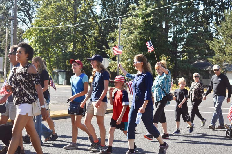 PMG PHOTO: EMILY LINDSTRAND - Participants in a recent event honoring first responders marched from Estacada High School to the Veterans Memorial.