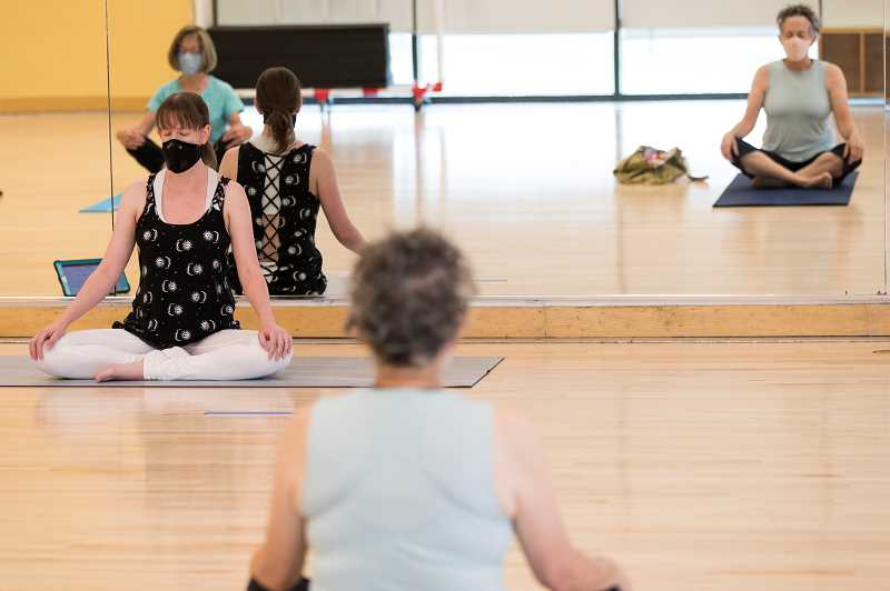 PMG PHOTOS: JAIME VALDEZ - Parker Gibson, left, leads a yoga class for Laura Nelson, back left, and Terry Rabot at Conestoga Recreation and Aquatic Center.