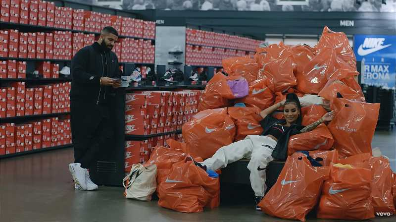 SCREENSHOT: LAUGH NOW CRY LATER MUSIC VIDEO/YOUTUBE - Drake counts money in his hands as hes surrounded by iconic, bright orange  Nike boxes and bags.