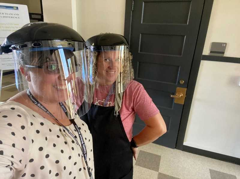PHOTO CONTRIBUTED BY KITSI BASS  - Stefanie Mickel, left, and Kitsi Bass show off their new face shields that the entire kitchen crew are now wearing in the Crook County School District's Nutritional Services Department.