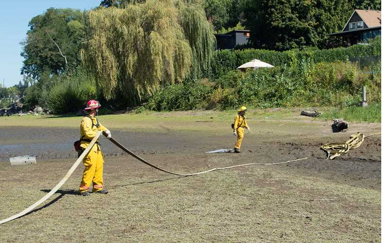 COURTESY PHOTO: PAM DENHAM - Firefighters used about 800 feet of hose to fully extinguish†the Elk Rock Island fire.