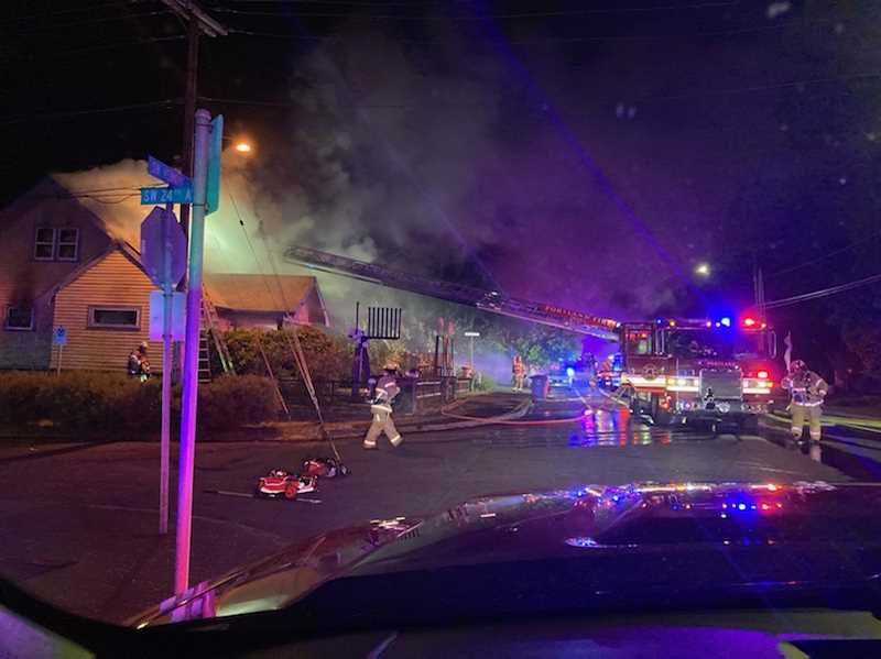 PHOTO COURTESY OF PORTLAND FIRE & RESCUE - Smoke billows from the Chabad Center for Jewish Life on Southwest Vermont Street during the early morning hours of Aug. 19, following a fire that is now deemed suspicious.