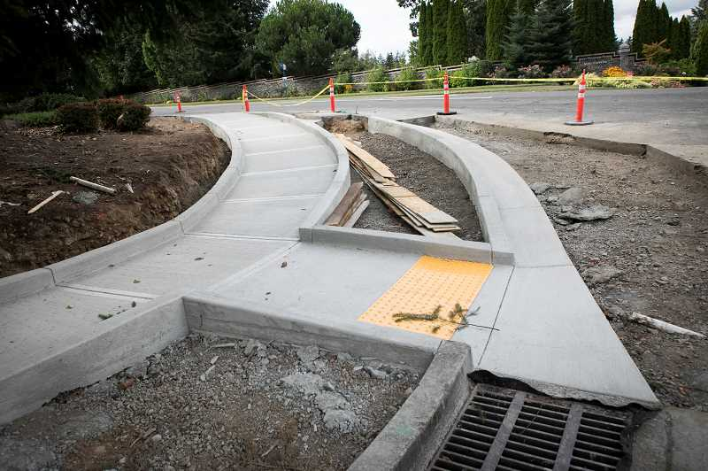 PMG PHOTO: JAIME VALDEZ - Ramps are being installed at Southwest Boones Ferry Road and Iowa Drive as part of roadwork undertaken by the city this summer.