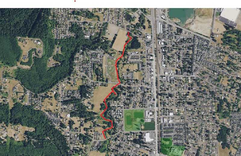 CITY OF SCAPPOOSE; ISAAC BUTMAN - A recent analysis of the proposed trail along South Scappoose Creek recommends a phased approach to construction.
