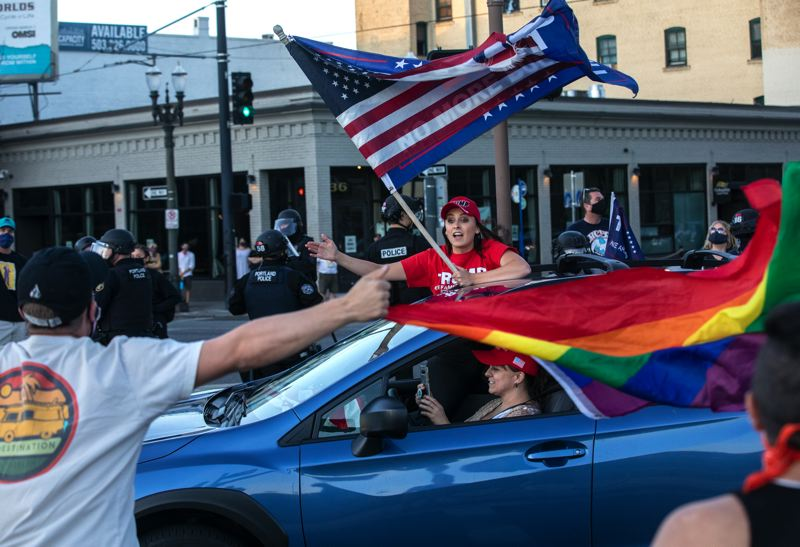 PMG PHOTO: JONATHAN HOUSE - A rolling caravan of President Trump supporters battled with local counter-protesters Sarturday, Aug. 29, resulting in one man being shot and killed. Since then, Trump, Gov. Kate Brown and Oregon law enforcment leaders have entered the fray.