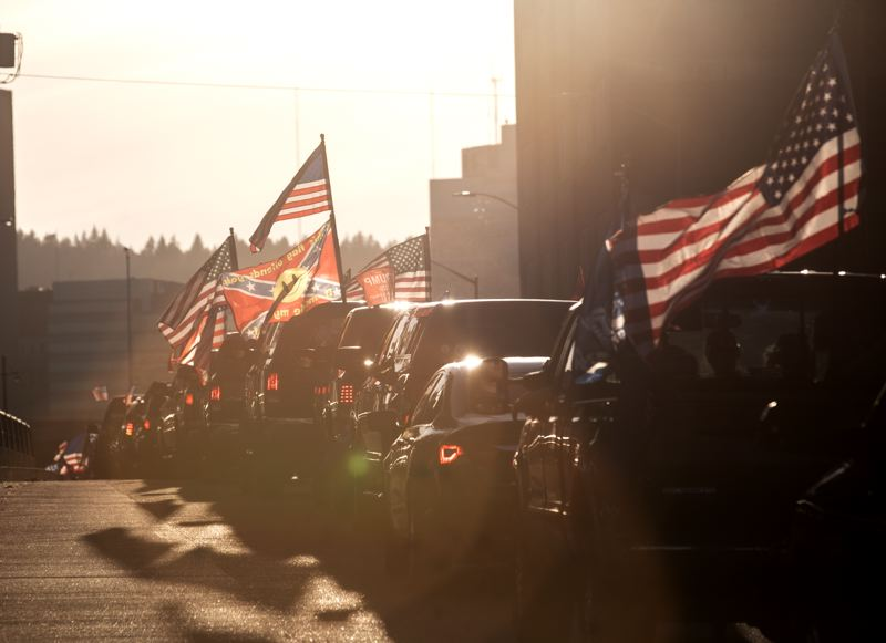 PMG PHOTO: JONATHAN HOUSE - A caravan of President Trump supporters came to town Saturday, Aug. 29, gathering at Clackamas Town Center and, by the afternoon, reaching downtown Portland.