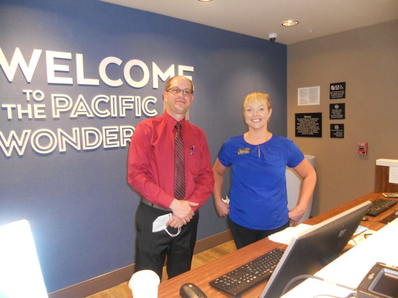 PMG PHOTO: SCOTT KEITH - Jeremiah Raymer, general manager, and Jenn Dolan, front desk associate, are part of the team at Hampton by Hilton Sherwood Portland.