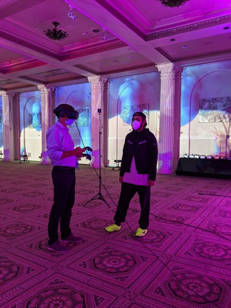 PMG PHOTO: JOSEPH GALLIVAN - Viewers of 'Venice VR Expanded 2020' at the Portland Art Museum, Sept 2 -12, put on sanitized virtual reality goggles and follow onscreen prompts to experience immersive environments. Here a viewer checks out the most sophisticated platform, the HTC Vive.