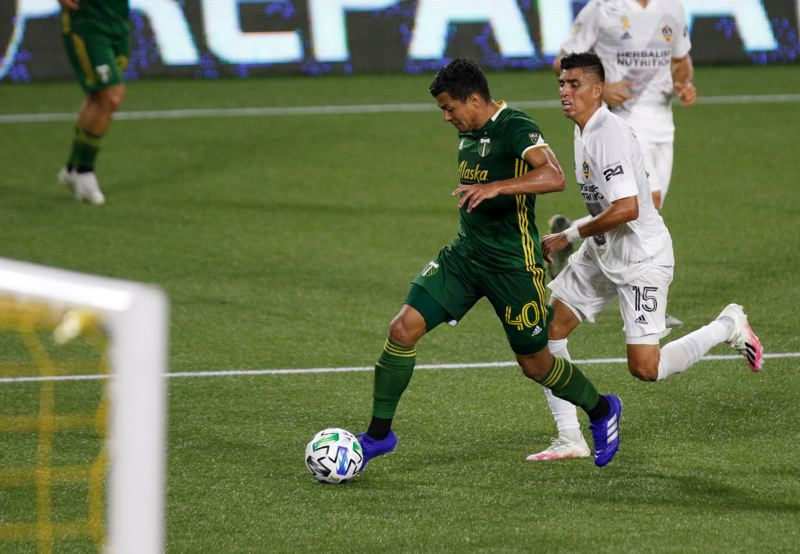 PMG PHOTO: JONATHAN HOUSE - Renzo Zambano dribbles into the penalty area, creating an opportunity that led to a Felipe Mora goal in the Timbers' 3-2 Wednesday loss to the LA Galaxy.