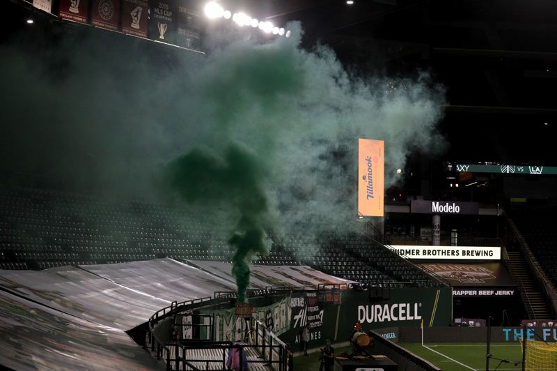 PMG PHOTO: JOHNATHAN HOUSE - There were no fans at Providence Park for Wednesday's Portland Timbers match against the LA Galaxy, but there was green smoke in celebration of the Timbers' goals.