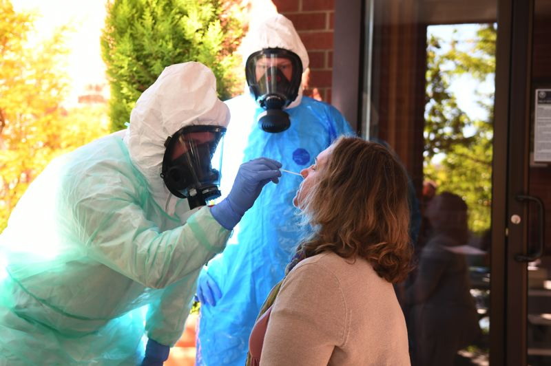 COURTESY PHOTO: DAVE ARPIN - Lake Oswego City Council President Jackie Manz volunteers to be tested for COVID-19 by Lake Oswego Fire Department members who are training to do testing in Clackamas County.