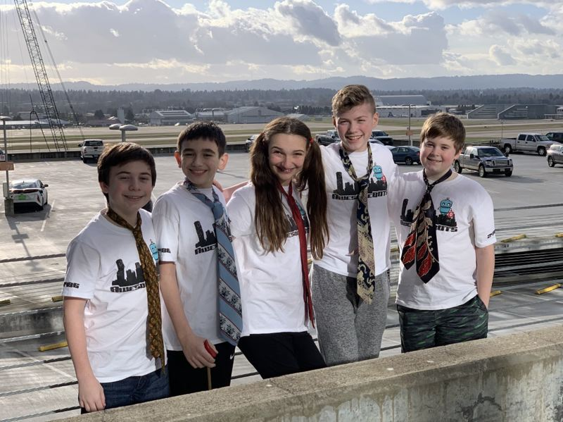 COURTESY PHOTO - Brady Grant, Nathan Hershman, Sophia Culp, Wilder Doblie and Ethan Grant make up the Awesomebots Robotics team, which won a grant from the city of Wilsonville to further develop its emergency preparedness game.