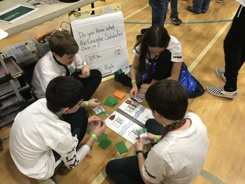COURTESY PHOTO - The Awesomebots Robotics Team plays the game they created.