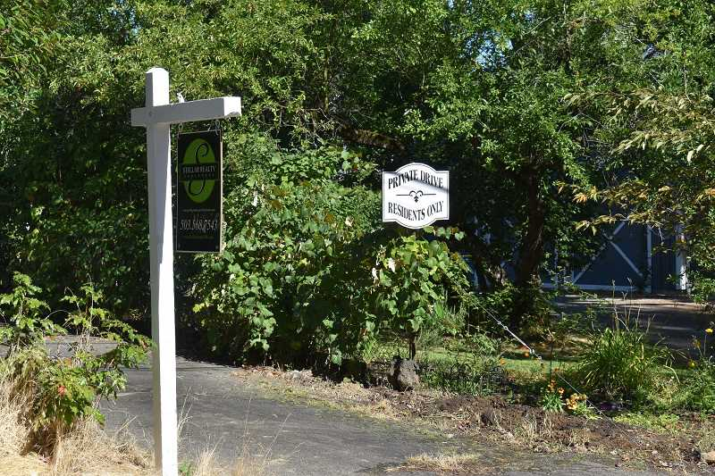 PMG PHOTO: RAYMOND RENDLEMAN - A realtor in Oregon City posted a sales sign next to a 'private drive' sign this summer. However, city officials said the alley actually remains a public right-of-way.