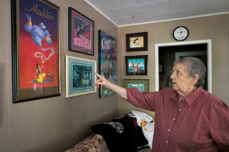 PMG PHOTO: JAIME VALDEZ - Marlene Robinson May displays some of the memorabilia she collected over her roughly 50 year career in animation.