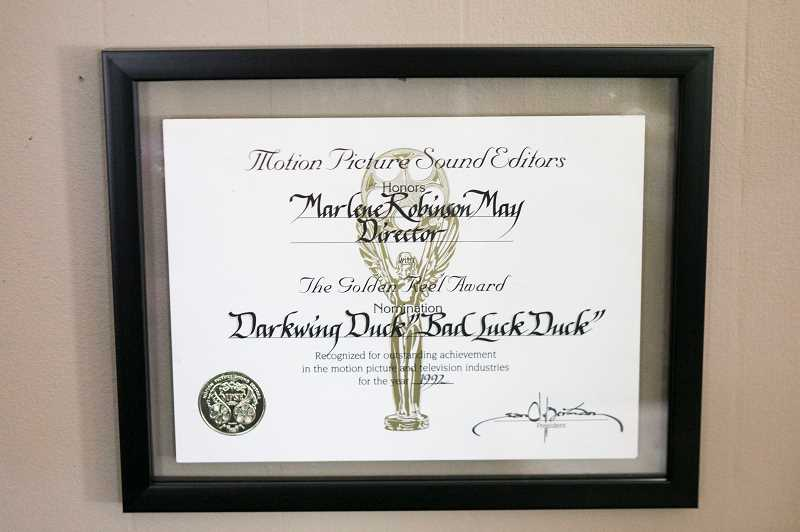 PMG PHOTO: JAIME VALDEZ - A certificate awarded to Marlene Robinson May for her work on the animated show 'Darkwing Duck.'