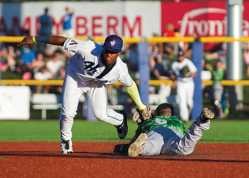 PMG FILE PHOTO - Hillsboro Hops shortstop Sergio Alcantara slaps a tag on Eugene's Donnie Dewees during a 2015 game against the Emeralds. Alcantara, since traded to the Detroit Tigers, made his major league debut this week.
