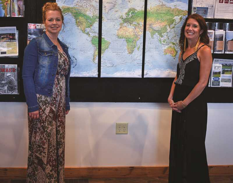 RAMONA MCCALLISTER - Pictured left, Amy Hurt, office administrator and Kim Daniels, executive director for the Prineville-Crook County Chamber of Commerce, stand in front of the world map they placed in the lobby of the chamber office. The map allows visitors to place a pin on the map where they are from.