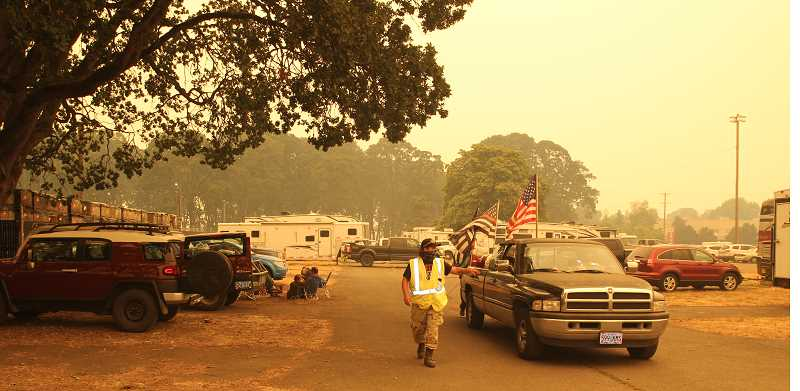 PMG PHOTO: JUSTIN MUCH - Volunteers roll through the Oregon State Fairgrounds evacuation center handing out milk to families who were displaced by wildfires in Santiam Canyon.