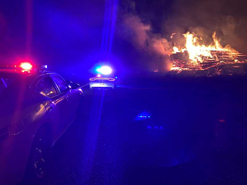 COURTESY PHOTO: CCSO - Emergency personnel respond to the fire that closed Highway 213 near Molalla and Oregon City for five hours.