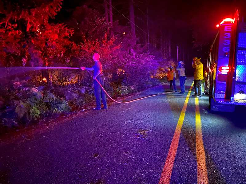 COURTESY PHOTO: CCSO - Crews work through the night on the South Unger Road fire.
