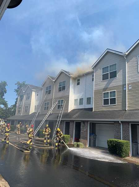 COURTESY PHOTO: TUALATIN VALLEY FIRE & RESCUE - According to Tualatin Valley Fire & Rescue, on multiple 9-1-1 calls were made at about 1:19 p.m. reporting a barbecue on a deck that was on fire. Firefighters later arrived on scene to find the fire had spread to multiple floors.