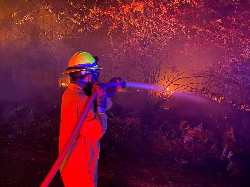 COURTESY PHOTO: CCSO - Fire crews fight flames at a Colton area fire off of South Unger Road on Tuesday, Sept. 8.