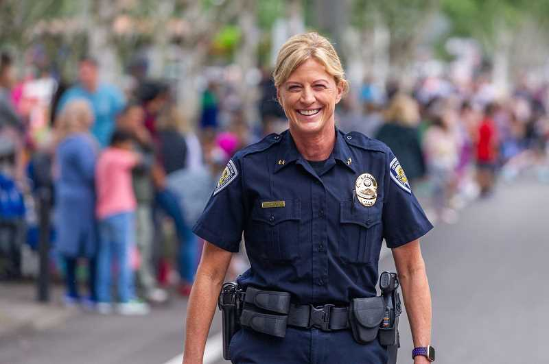 PMG FILE PHOTO - Beaverton Police Chief Ronda Groshong marches in the Beaverton Celebration Parade in downtown Beaverton last year. Groshong's department is collaborating with Beavertons Human Rights Advisory Commission to create dialogue with the public.