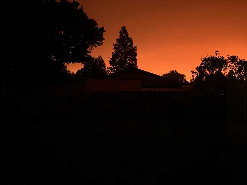 PMG PHOTO: SANDY STOREY - Molalla's skies are filled with a red haze, smoke and ash on Wedesday, Sept. 9.